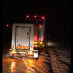 Bus forced from road by flash flood