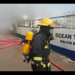 Dramatic scenes unfold as vessel burns in harbour